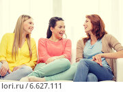 Купить «three girlfriends having a talk at home», фото № 6627111, снято 12 апреля 2014 г. (c) Syda Productions / Фотобанк Лори