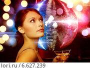 Купить «woman with cocktail and disco ball», фото № 6627239, снято 12 декабря 2010 г. (c) Syda Productions / Фотобанк Лори