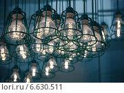 Купить «Стилизованные под ретро светильники с современными светодиодными лампами», фото № 6630511, снято 13 сентября 2014 г. (c) EugeneSergeev / Фотобанк Лори