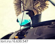 Купить «closeup of man pouring antifreeze into water tank», фото № 6630547, снято 16 января 2014 г. (c) Syda Productions / Фотобанк Лори