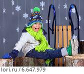 Портрет счастливого мальчика в зимней одежде. Стоковое фото, фотограф Максим Топчий / Фотобанк Лори