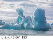 Купить «Айсберг необычной формы в Северном Ледовитом океане», фото № 6661183, снято 20 августа 2013 г. (c) Николай Гернет / Фотобанк Лори
