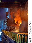 Цех металлургического комбината, ковш с жидким металлом. Стоковое фото, фотограф Iordache Carmen Anne Marie / Фотобанк Лори