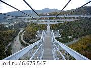 Купить «Подвесной мост над пропастью, Skypark, Сочи», фото № 6675547, снято 31 октября 2014 г. (c) Денис Иванов / Фотобанк Лори