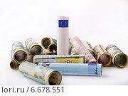 Банкноты евро и доллары скрученные в трубочки. Стоковое фото, фотограф Николай Фролочкин / Фотобанк Лори