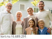 Купить «happy family in front of house outdoors», фото № 6689291, снято 21 августа 2014 г. (c) Syda Productions / Фотобанк Лори