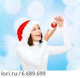 Купить «woman in santa helper hat with christmas ball», фото № 6689699, снято 15 августа 2013 г. (c) Syda Productions / Фотобанк Лори