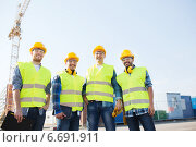 Купить «group of smiling builders with tablet pc outdoors», фото № 6691911, снято 21 сентября 2014 г. (c) Syda Productions / Фотобанк Лори