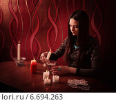 Купить «Divination with candle», фото № 6694263, снято 10 января 2014 г. (c) Майя Крученкова / Фотобанк Лори