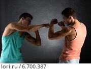 Купить «young men wrestling», фото № 6700387, снято 22 сентября 2014 г. (c) Syda Productions / Фотобанк Лори