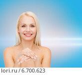 Купить «face and hands of beautiful woman», фото № 6700623, снято 15 апреля 2014 г. (c) Syda Productions / Фотобанк Лори