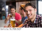 Купить «Young man holding pint of beer», фото № 6700927, снято 27 июня 2014 г. (c) Wavebreak Media / Фотобанк Лори