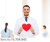 Купить «smiling male doctor with red heart», фото № 6704843, снято 10 мая 2014 г. (c) Syda Productions / Фотобанк Лори