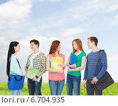 Купить «group of smiling students standing», фото № 6704935, снято 4 мая 2014 г. (c) Syda Productions / Фотобанк Лори