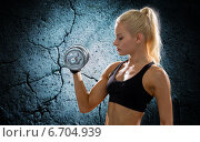 Купить «young sporty woman with heavy steel dumbbell», фото № 6704939, снято 8 мая 2014 г. (c) Syda Productions / Фотобанк Лори