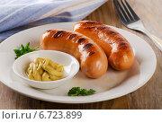 Купить «Two sausages with mustard and herbs», фото № 6723899, снято 24 ноября 2014 г. (c) Tatjana Baibakova / Фотобанк Лори