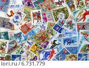 Купить «Фон из почтовых марок СССР разных лет, объединенных темой Спорт», эксклюзивное фото № 6731779, снято 29 ноября 2014 г. (c) Иван Марчук / Фотобанк Лори