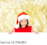 Купить «woman in santa helper hat with blank white board», фото № 6734851, снято 15 августа 2013 г. (c) Syda Productions / Фотобанк Лори