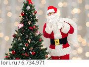 Купить «santa claus with bag and christmas tree», фото № 6734971, снято 10 сентября 2014 г. (c) Syda Productions / Фотобанк Лори