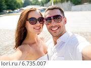 Купить «smiling couple wearing sunglasses making selfie», фото № 6735007, снято 23 июля 2014 г. (c) Syda Productions / Фотобанк Лори