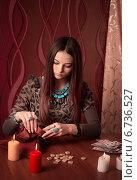 Купить «Young woman with runes and divination cards in room», фото № 6736527, снято 10 января 2014 г. (c) Майя Крученкова / Фотобанк Лори