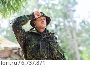Купить «young soldier or ranger in forest», фото № 6737871, снято 14 августа 2014 г. (c) Syda Productions / Фотобанк Лори