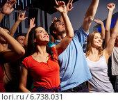 Купить «smiling friends at concert in club», фото № 6738031, снято 20 октября 2014 г. (c) Syda Productions / Фотобанк Лори