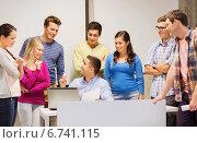 Купить «group of students and teacher with laptop», фото № 6741115, снято 7 сентября 2014 г. (c) Syda Productions / Фотобанк Лори