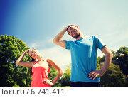 Купить «smiling couple stretching outdoors», фото № 6741411, снято 3 июля 2014 г. (c) Syda Productions / Фотобанк Лори