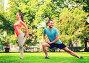 smiling couple stretching outdoors, фото № 6742663, снято 3 июля 2014 г. (c) Syda Productions / Фотобанк Лори