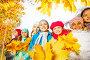 Дети с букетами жёлтых листьев в осеннем парке, фото № 6751103, снято 12 октября 2014 г. (c) Сергей Новиков / Фотобанк Лори