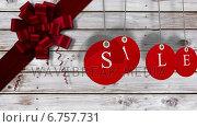 Купить «Red sale tags hanging against wood with festive bow», видеоролик № 6757731, снято 31 мая 2020 г. (c) Wavebreak Media / Фотобанк Лори