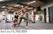 Купить «man and woman with barbell flexing muscles in gym», видеоролик № 6760859, снято 1 декабря 2014 г. (c) Syda Productions / Фотобанк Лори