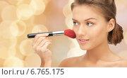 Купить «beautiful smiling woman with make up brush», фото № 6765175, снято 28 августа 2011 г. (c) Syda Productions / Фотобанк Лори
