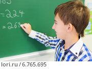 Купить «little smiling schoolboy writing on chalk board», фото № 6765695, снято 15 ноября 2014 г. (c) Syda Productions / Фотобанк Лори