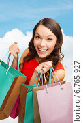 Купить «smiling woman with colorful shopping bags», фото № 6765927, снято 22 сентября 2013 г. (c) Syda Productions / Фотобанк Лори