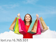 Купить «smiling woman with colorful shopping bags», фото № 6765931, снято 22 сентября 2013 г. (c) Syda Productions / Фотобанк Лори