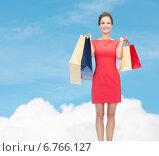 Купить «smiling elegant woman in dress with shopping bags», фото № 6766127, снято 1 июня 2014 г. (c) Syda Productions / Фотобанк Лори