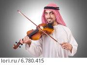 Купить «Arab man playing music on white», фото № 6780415, снято 27 октября 2012 г. (c) Elnur / Фотобанк Лори