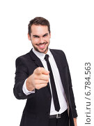 Купить «Happy businessman pointing at camera», фото № 6784563, снято 25 июня 2014 г. (c) Wavebreak Media / Фотобанк Лори