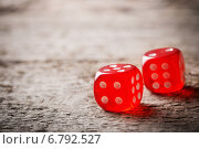 Купить «Pair of thrown red dices on old wooden table», фото № 6792527, снято 10 марта 2014 г. (c) Майя Крученкова / Фотобанк Лори