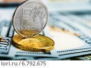 Купить «Российский рубль лежит на долларах», фото № 6792675, снято 23 ноября 2014 г. (c) Валерия Потапова / Фотобанк Лори