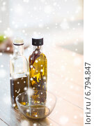 Купить «close up of two olive oil bottles and glass bowl», фото № 6794847, снято 21 января 2014 г. (c) Syda Productions / Фотобанк Лори