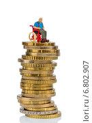 woman in wheelchair on money stack. Стоковое фото, фотограф Erwin Wodicka / Фотобанк Лори
