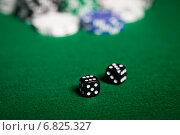 close up of black dices on green casino table. Стоковое фото, фотограф Syda Productions / Фотобанк Лори