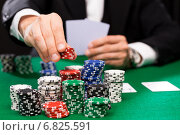 Купить «poker player with cards and chips at casino», фото № 6825591, снято 16 мая 2014 г. (c) Syda Productions / Фотобанк Лори