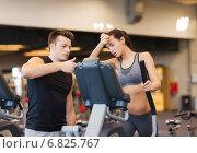 Купить «woman with trainer exercising on stepper in gym», фото № 6825767, снято 30 ноября 2014 г. (c) Syda Productions / Фотобанк Лори