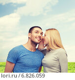 Купить «smiling girlfriend telling boyfriend secret», фото № 6826059, снято 9 февраля 2014 г. (c) Syda Productions / Фотобанк Лори