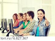 Купить «female student with classmates in computer class», фото № 6827367, снято 4 мая 2014 г. (c) Syda Productions / Фотобанк Лори