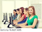 Купить «female student with classmates in computer class», фото № 6827435, снято 4 мая 2014 г. (c) Syda Productions / Фотобанк Лори